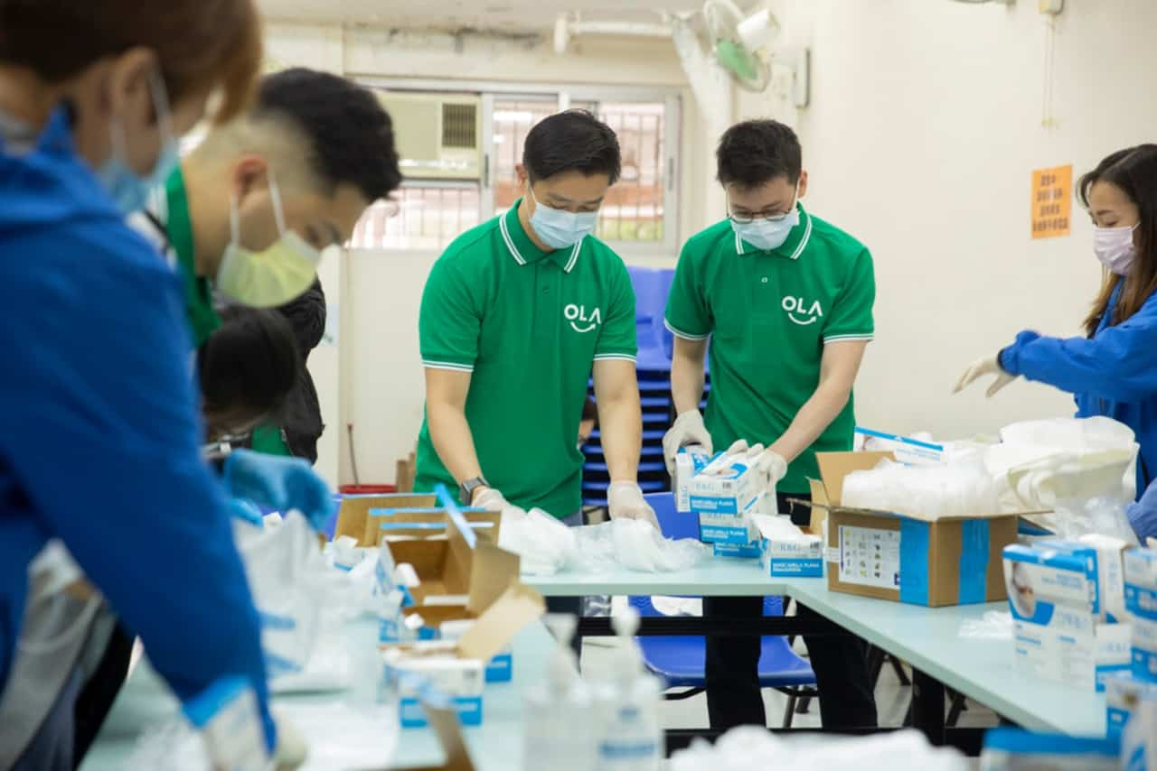 ola tech founders and employees packing masks to be distributed to elderly homes during COVID-19